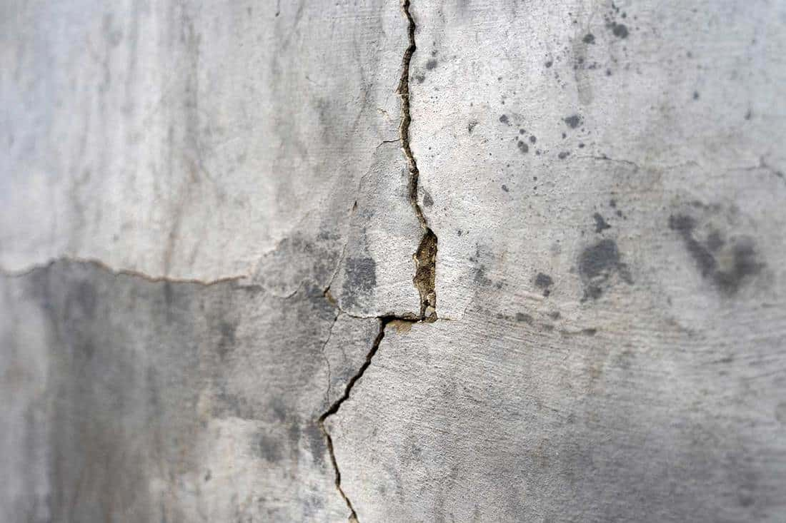Old foundation and plaster wall with cracks