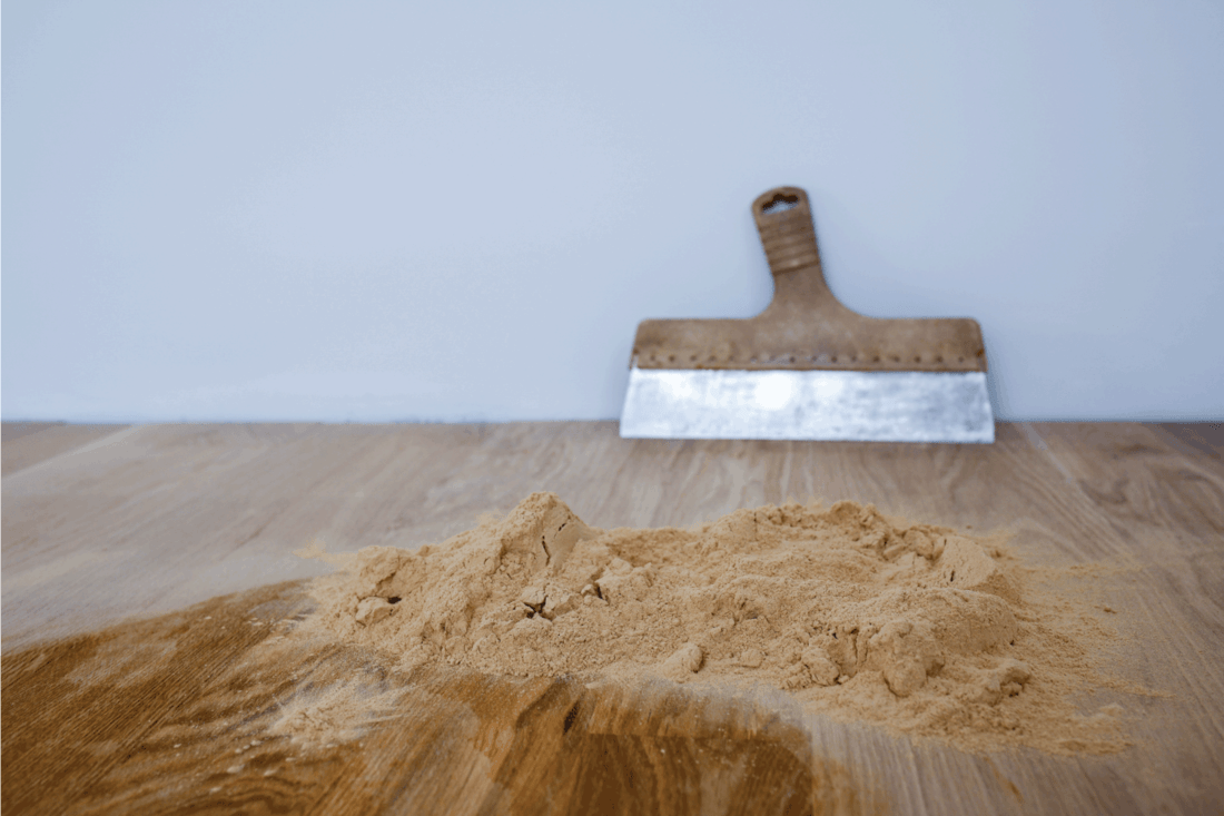 Preparation of parquet grout material. Mixing retainer, varnish and a small mixture of wood
