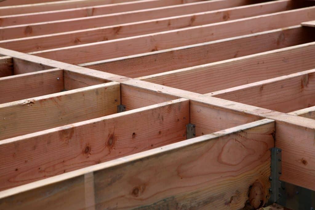Pressure treated wood floor beam