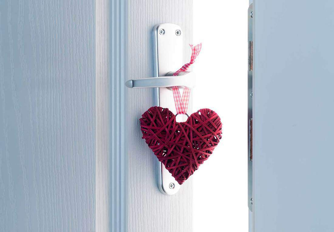 Red heart on a white door