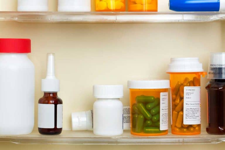 Several containers of over the counter and prescription medications on the shelves of a medicine cabinet, Do Bathrooms Need Medicine Cabinets Or Are They Outdated?