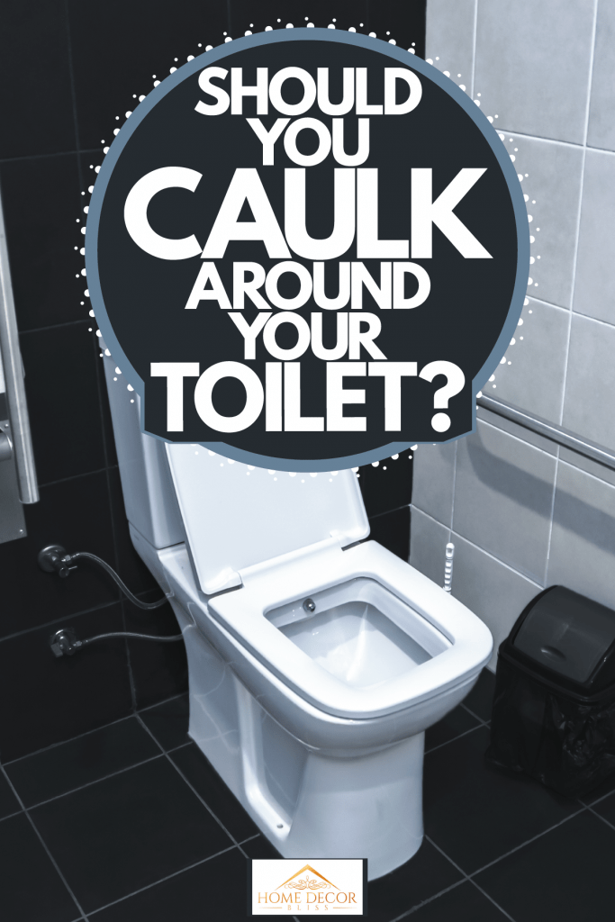 A toilet inside a black and white themed living room, Should You Caulk Around Your Toilet?