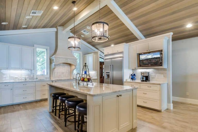 Slightly sloped wood panel ceiling in kitchen, 8 Of The Best Lighting Options For A Sloped Ceiling