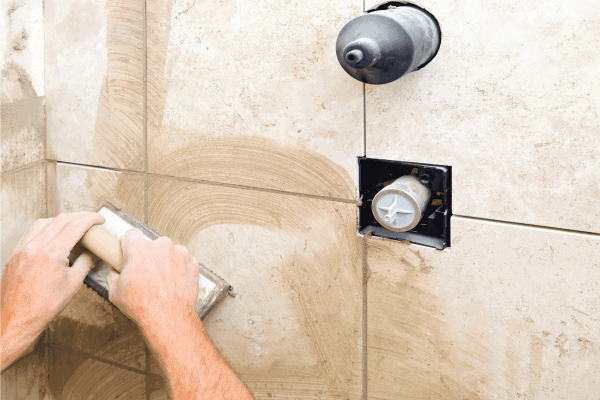 Read more about the article Why Is My Bathroom Grout Cracking? [And How To Fix That]