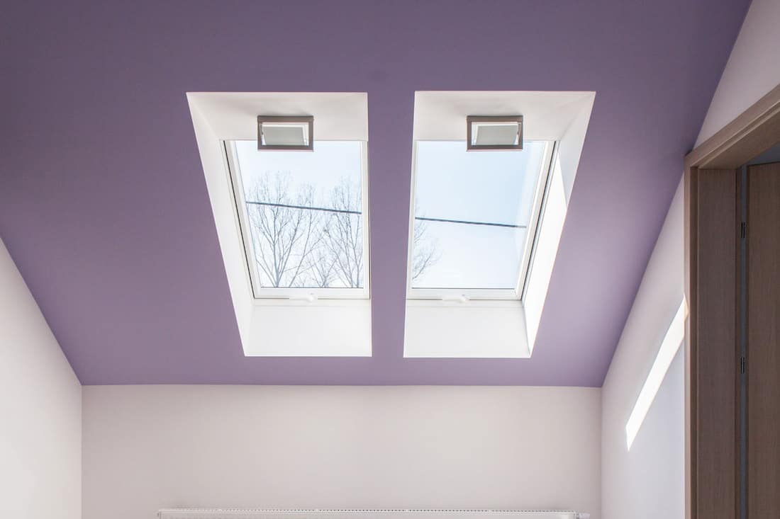 Violet slanted ceiling in empty attic room, What Color Do You Paint A Sloped Ceiling?