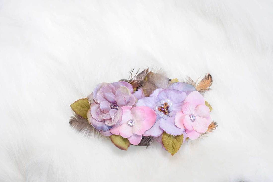 Wedding Hydrangea hair accessories isolated on the white fur coat