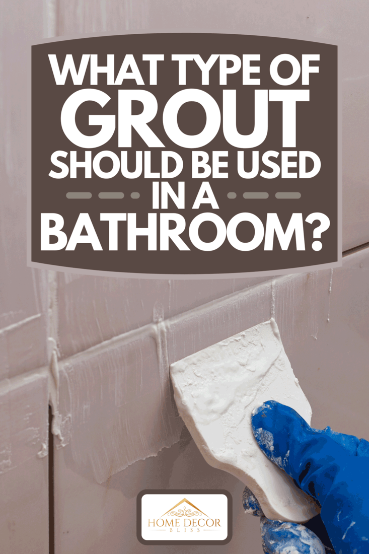 Person adding grout to tiles using rubber spatula, What Type Of Grout Should Be Used In A Bathroom?