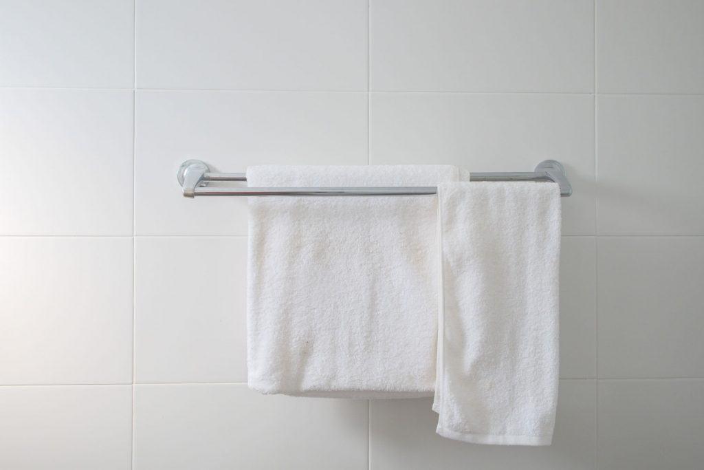 White towels hanged inside the bathroom