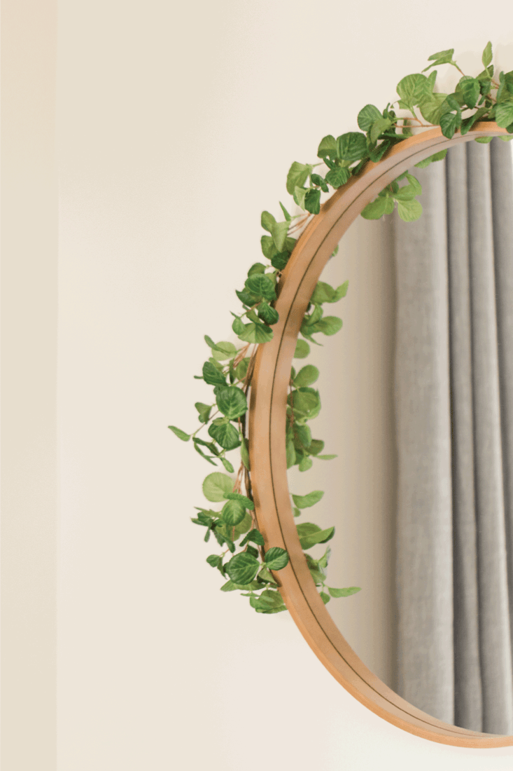 Wooden Mirror on a Wall with English Ivy On It