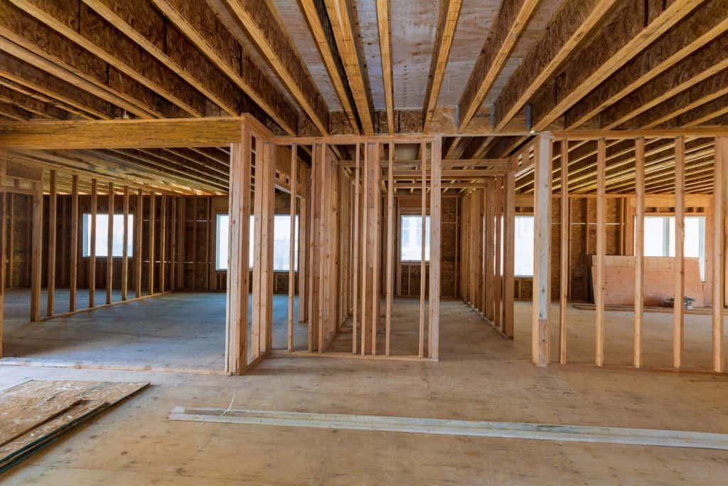 Wooden construction of a house under construction with unsealed walls and ceiling