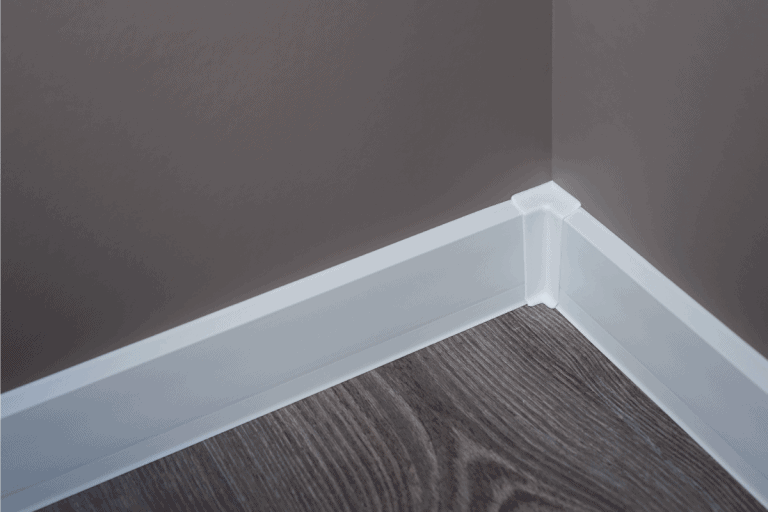 white baseboard with corner element. Should You Glue Or Nail Baseboards