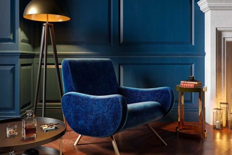 A classic royal blue color interior with armchair, fireplace, candle, floor lamp and carpet, 17 Beautiful Blue Living Room Color Schemes You Need To See