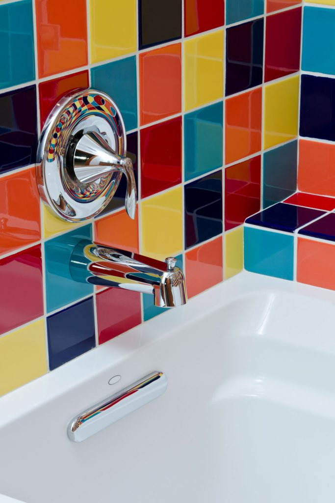 A gorgeous multi colored bathroom backsplash