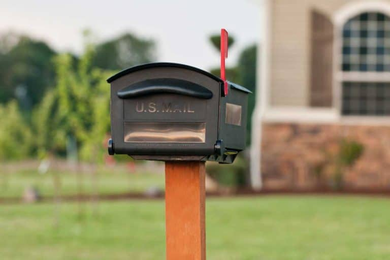 A mailbox outside of an American house, How Deep Should A Mailbox Post Be? [A Complete Guide]