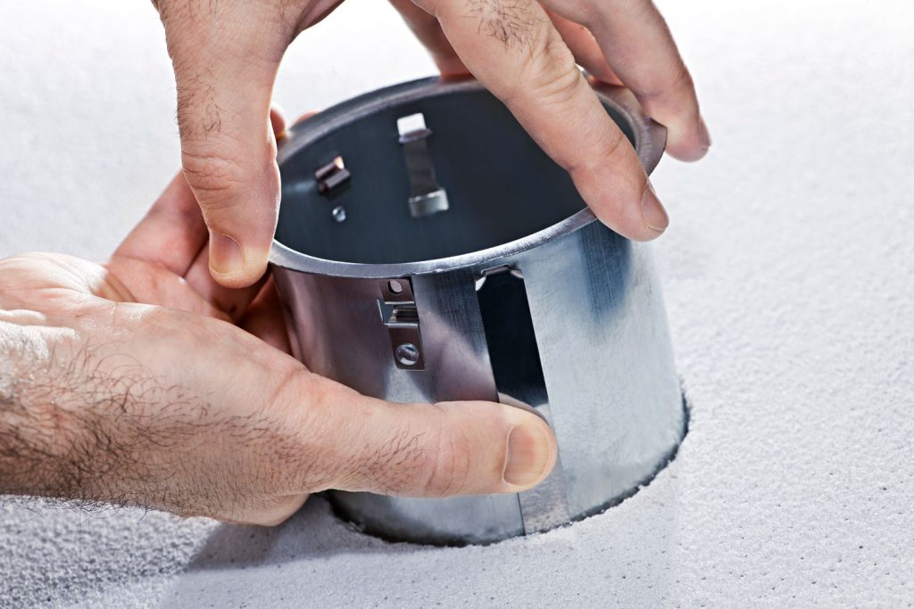 A man placing can for the recessed lighting