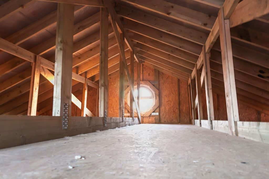 Attic with wooden beams inside a new house under construction