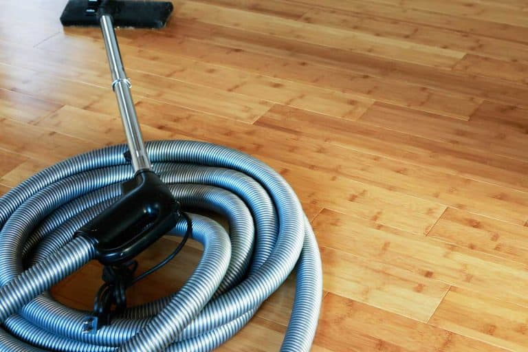 Beautiful bamboo hardwood floor with a central vacuum cleaner, 3 Types Of Central Vacuum Hoses To Know