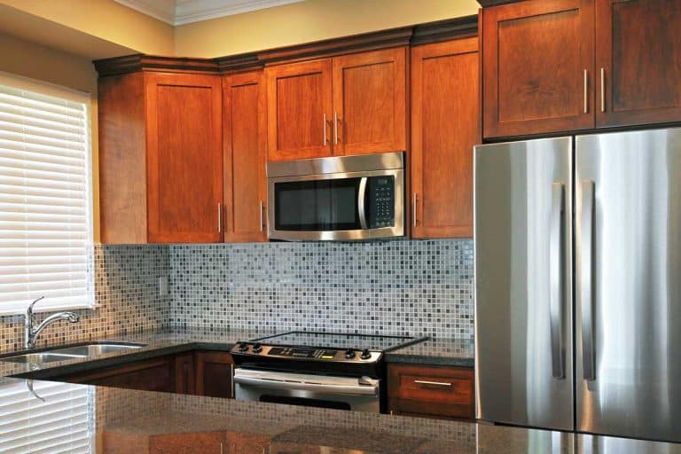 Bright modern kitchen interior with wooden cabinets, What Color Hardware Goes With Oak Cabinets?