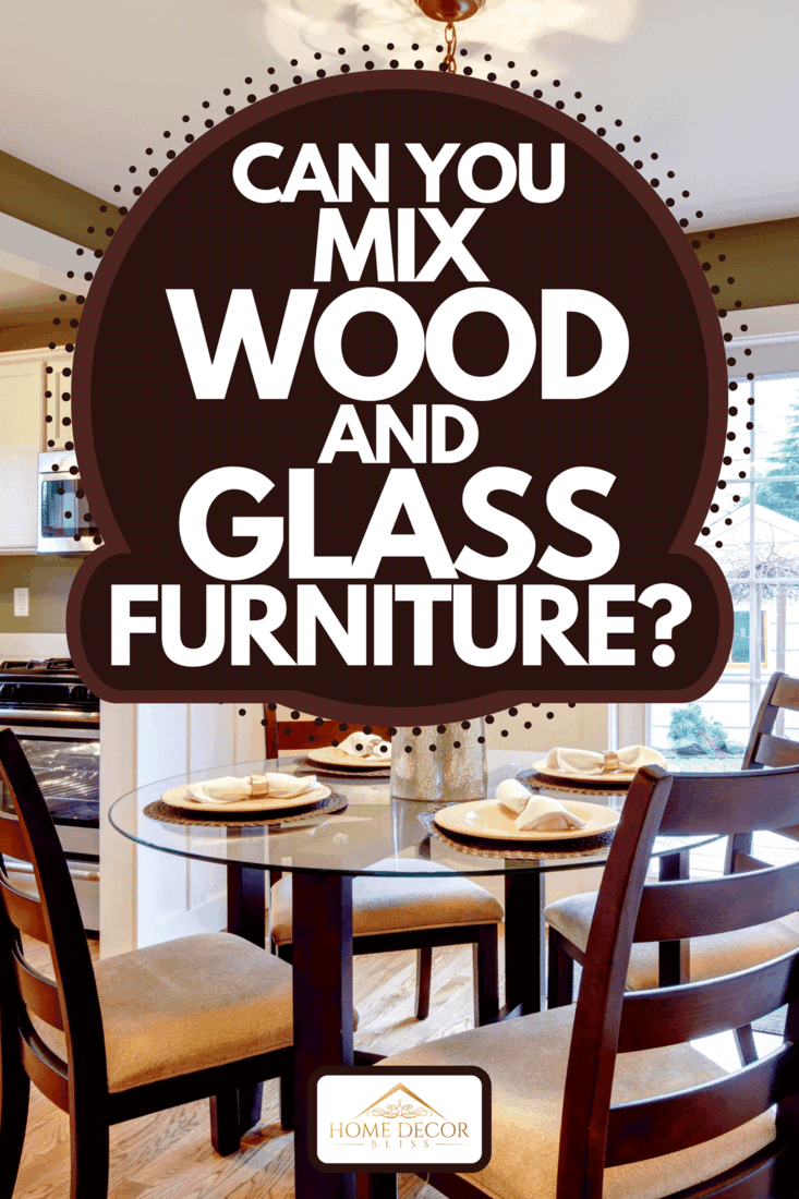 Beautifully decorated dining table with glass vase and dry branches, Can You Mix Wood And Glass Furniture?