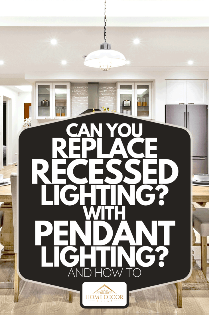 Modern dining room with hanging lamps on, chairs and table setup with fancy items on the wooden floor, Can You Replace Recessed Lighting With Pendant Lighting? [And How To]
