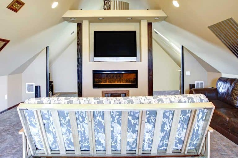 Chic attic living room with sloped ceiling, How To Mount A TV On A Sloped Ceiling [A Complete Guide]