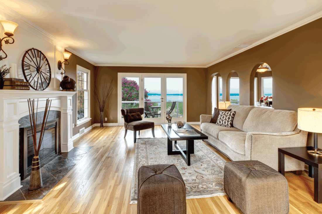 Classic brown living room with white fireplace and brown