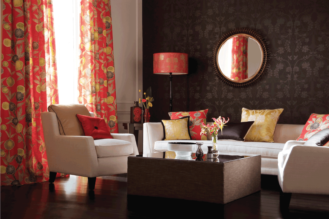 Contemporary lounge living room seating area, with ormaments. coral, gold, and brown