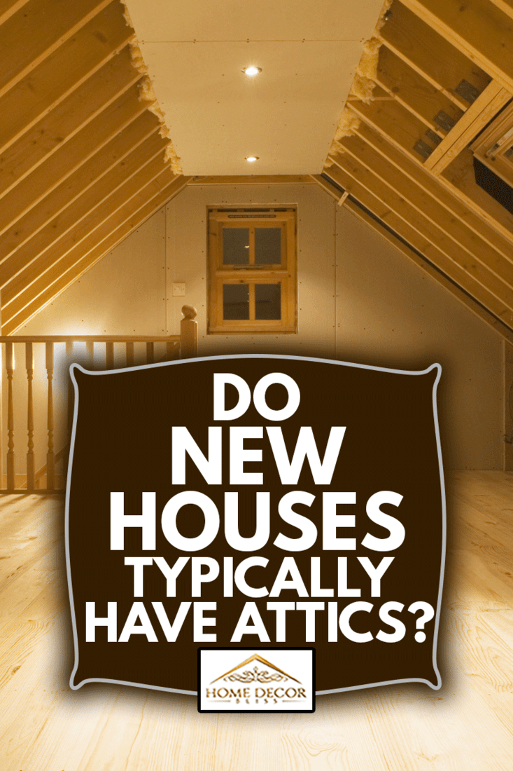 Nearly finished loft conversion with beams still exposed, and new wooden floor, Do New Houses Typically Have Attics?