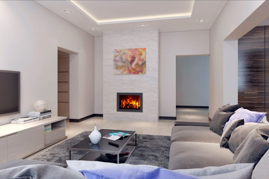 Elegant interior of a white painted living room with gray sectional sofa, white tiled flooring, and a fireplace on the corner of the living room