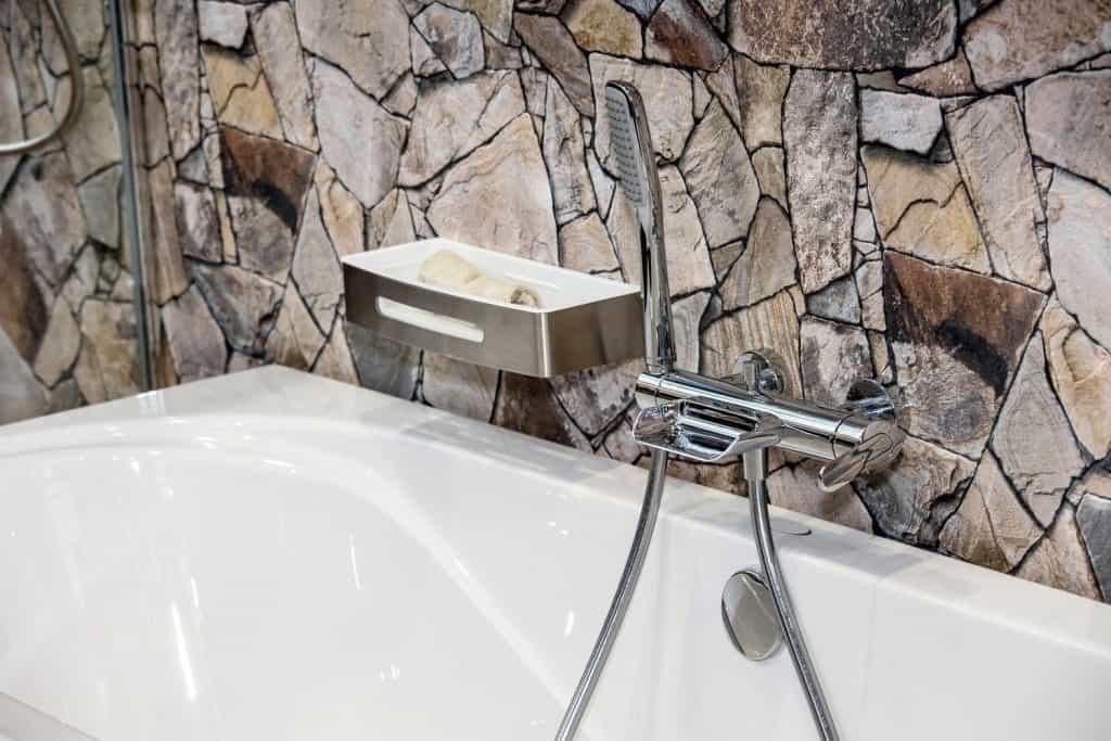 Gorgeous stunning stone decor on the bathtub wall