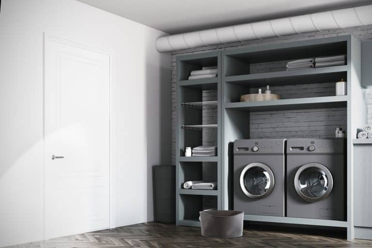 Gray colored washer and dryer inside a contemporary laundry room, Does A New House Come With Appliances?