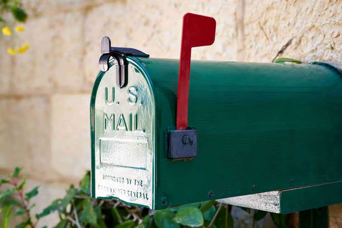 Green US post mail letter box with red flag raised up, Does The Flag On A Mailbox Have To Be Red?