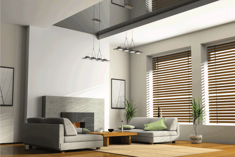 Home interior with fireplace, sofas, and window blinds. Does A New House Come With Blinds