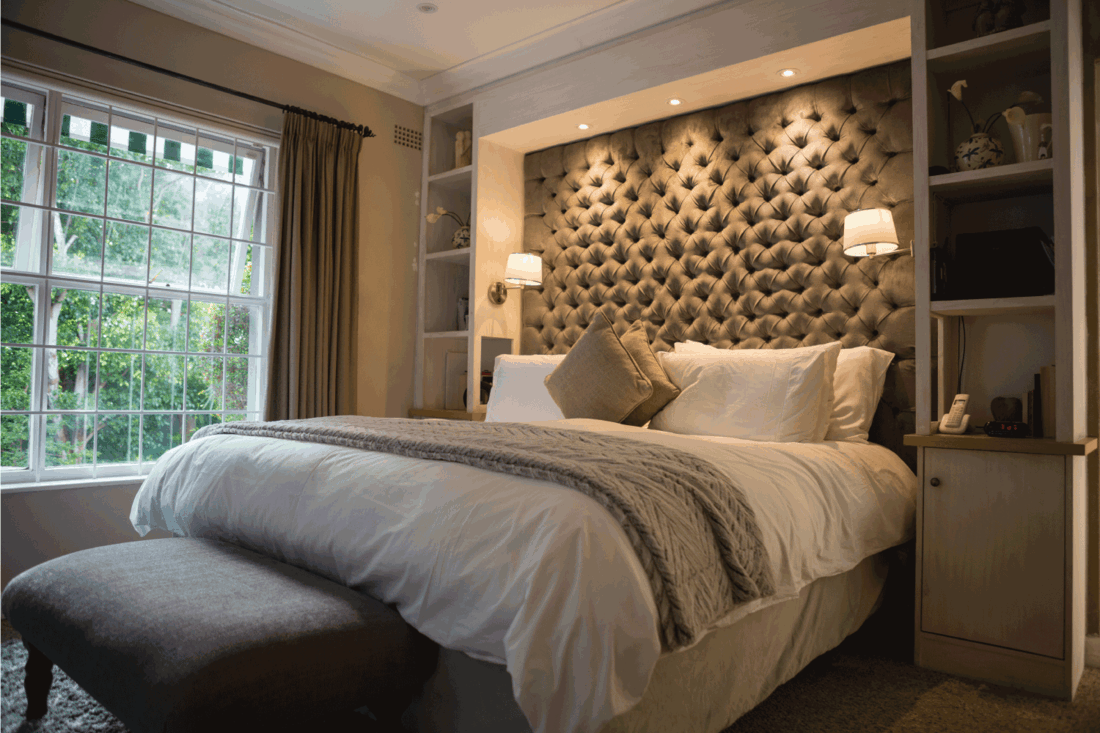 Illuminated neat bedroom at home with Above Bed Trio recessed lighting