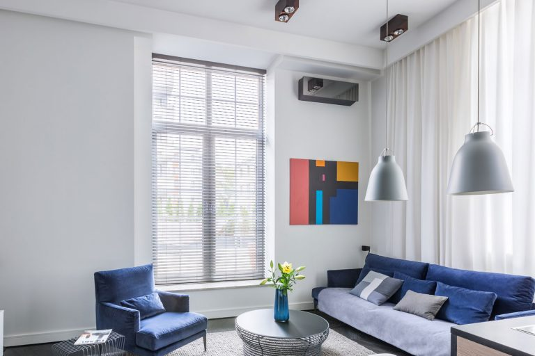 Industrial design in living room with tv and blue furniture set, blinds in grey walls, What Color Blinds Go With Grey Walls?