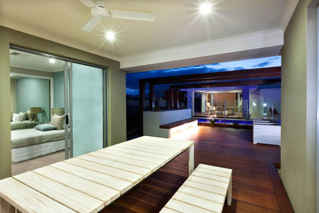 Interior lighting of a modern house with patio area at night