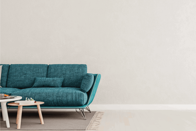 Living room interior wall mock up with teal blue sofa, empty white wall with free space on right. 11 Living Room Ideas With Teal Sofa