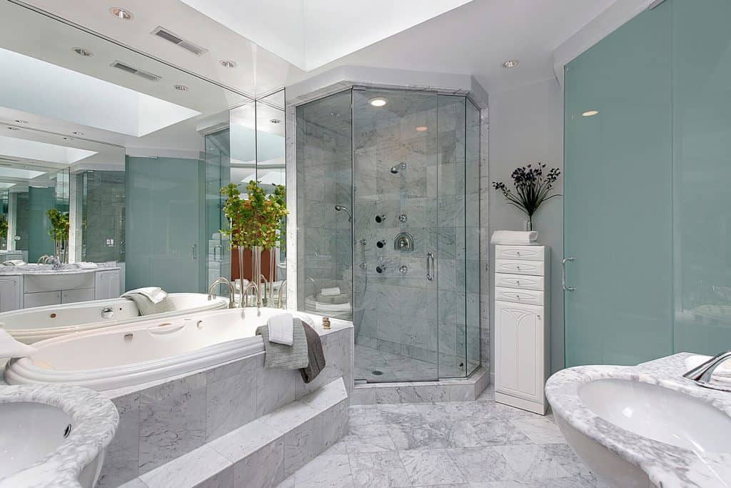 Modern contemporary interior of a bathroom with a semi octagon shaped glass shower wall