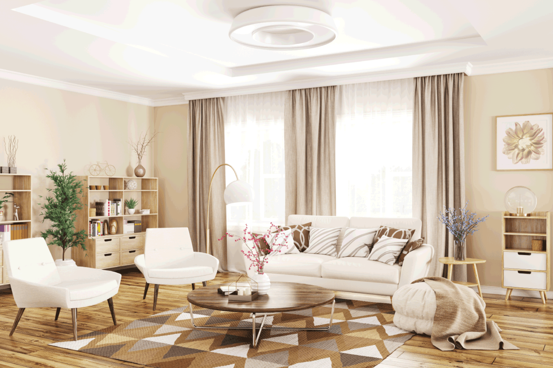 Modern interior of living room with white sofa, armchairs and coffee table