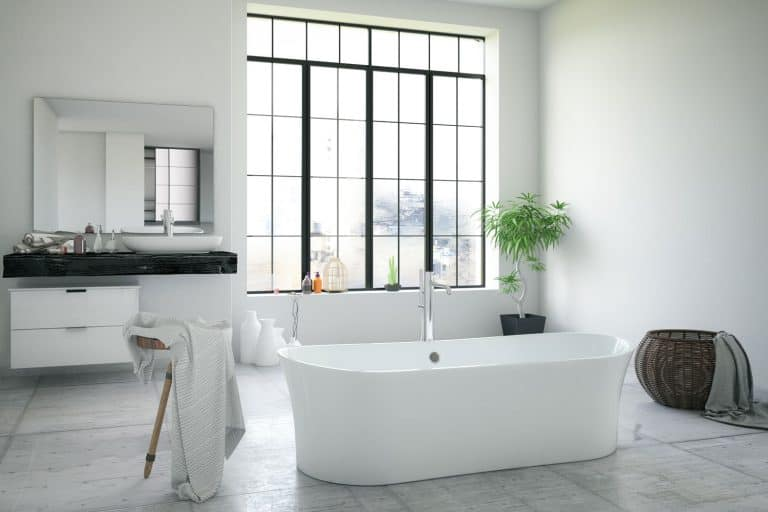 Modern spacious contemporary bathroom with a white bathtub and a huge window, How Wide Is A Bathtub?