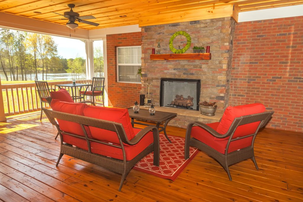 Rattan chairs with red foam in a Rustic wooden inspired lanai