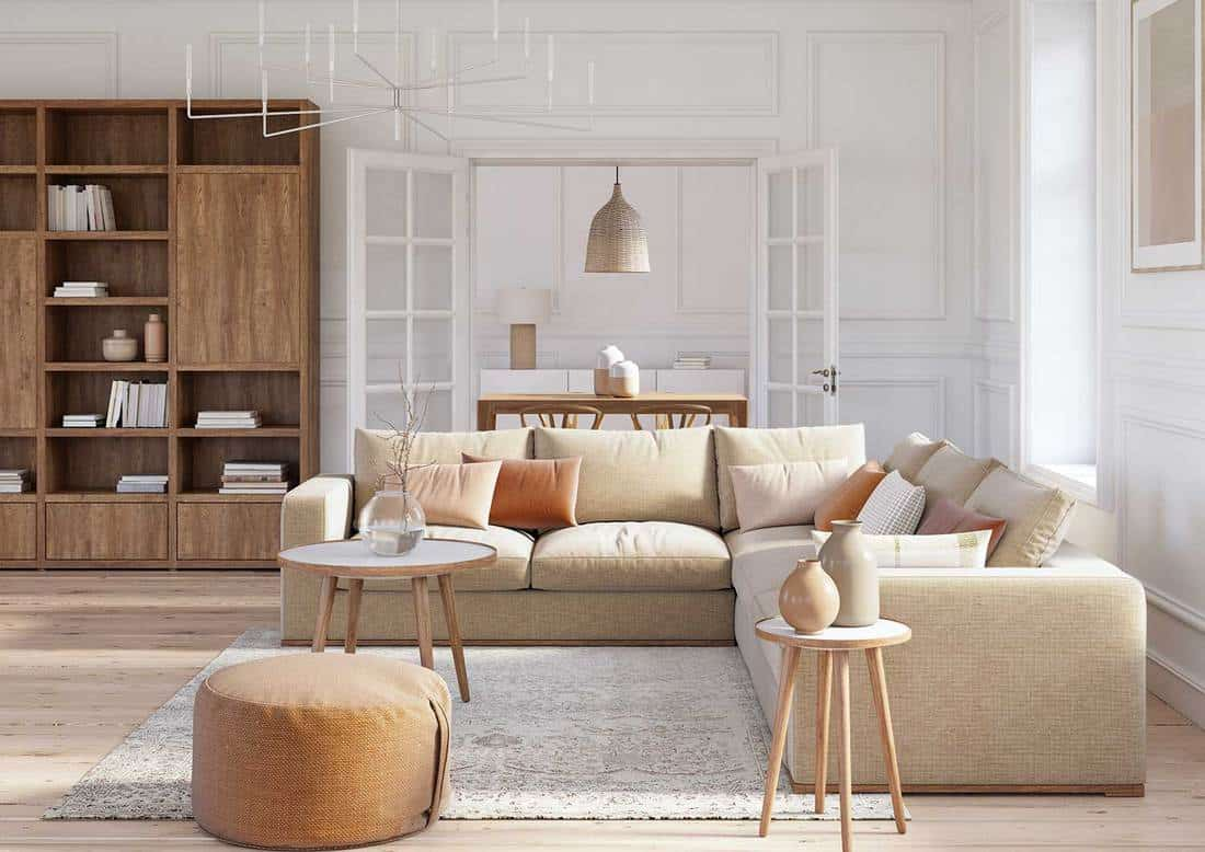 Scandinavian interior design living room with beige colored furniture and wooden elements