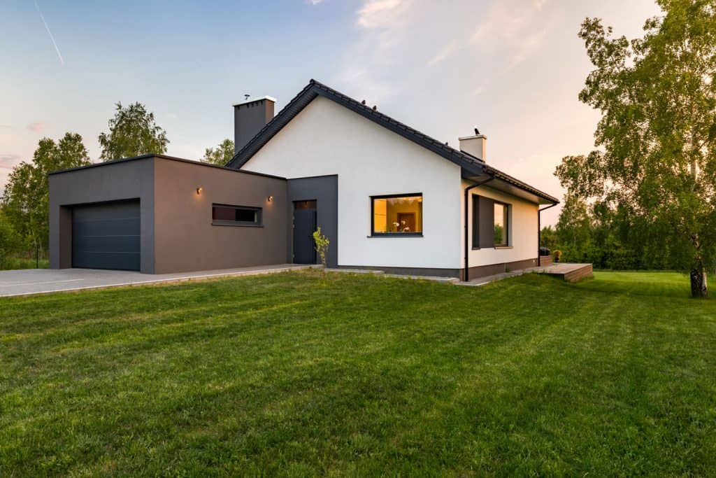 Single storey modern country home with white painted walls and an extended garage