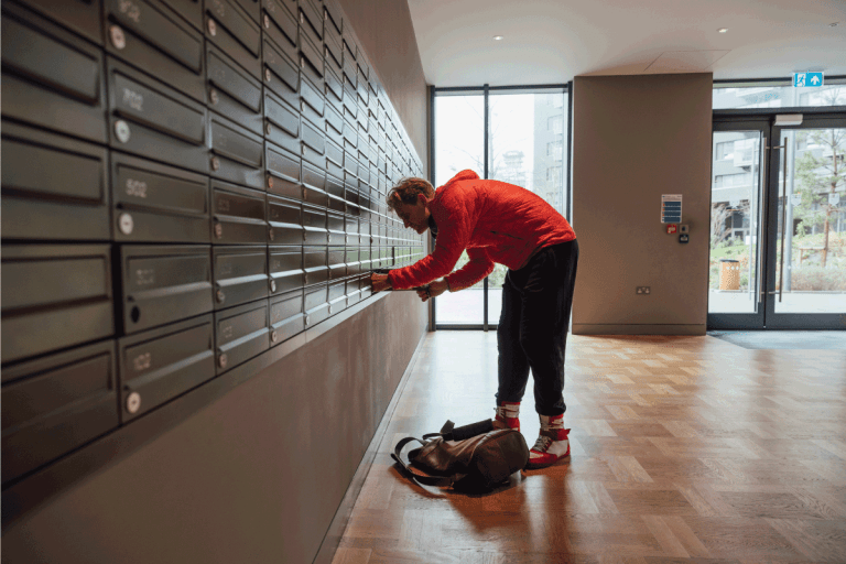 caucasian man unlocking his mailbox at his apartment. How To Get The Mailbox Key For New House