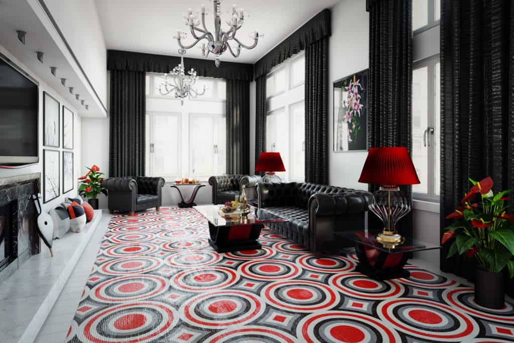 luxurious and stylish home interior design with black Chesterfield sofa and armchairs, Art Deco style tables, fireplace and a big three toned abstract rug