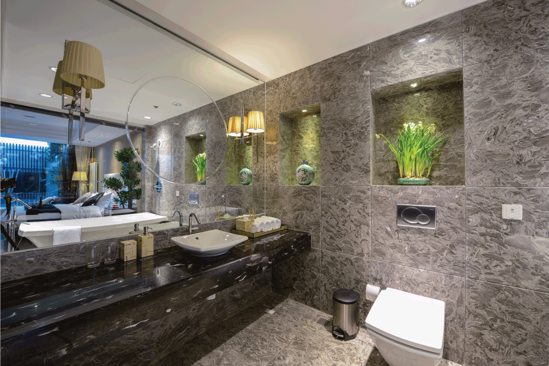 modern bathroom with large vanity mirror and recessed lighting