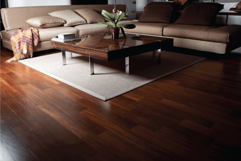 modern living room with brown wood tiles, light brown leather sofa, wooden center table with plant. 17 Awesome Brown Living Room Color Schemes To Inspire You