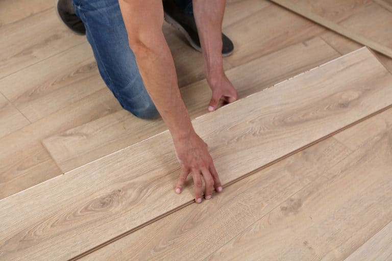 A floor installer putting wooden flooring without spacing, Should There Be Gaps In A New Hardwood Floor?