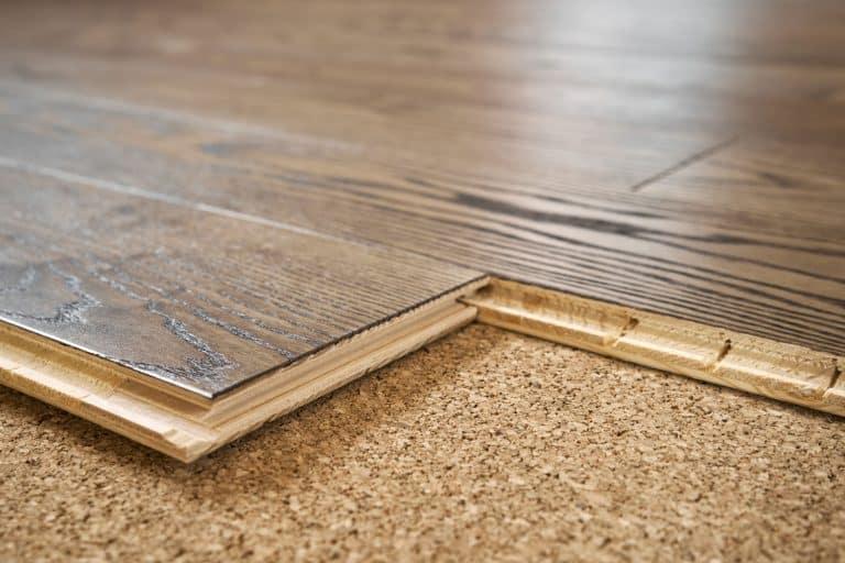 An up close photo of carpet padding and vinyl plank flooring, How To Install Vinyl Plank Flooring Over Carpet Padding