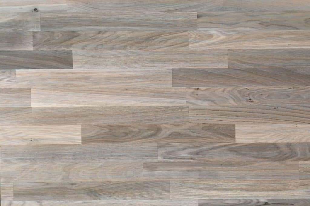 An-up-close-photo-of-the-patterns-in-a-wooden-flooring